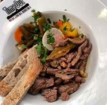 Steak tips with jalapeños and pickled vegetables
