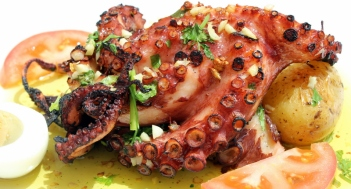 Freshly grilled octopus with boiled eggs and potatoes